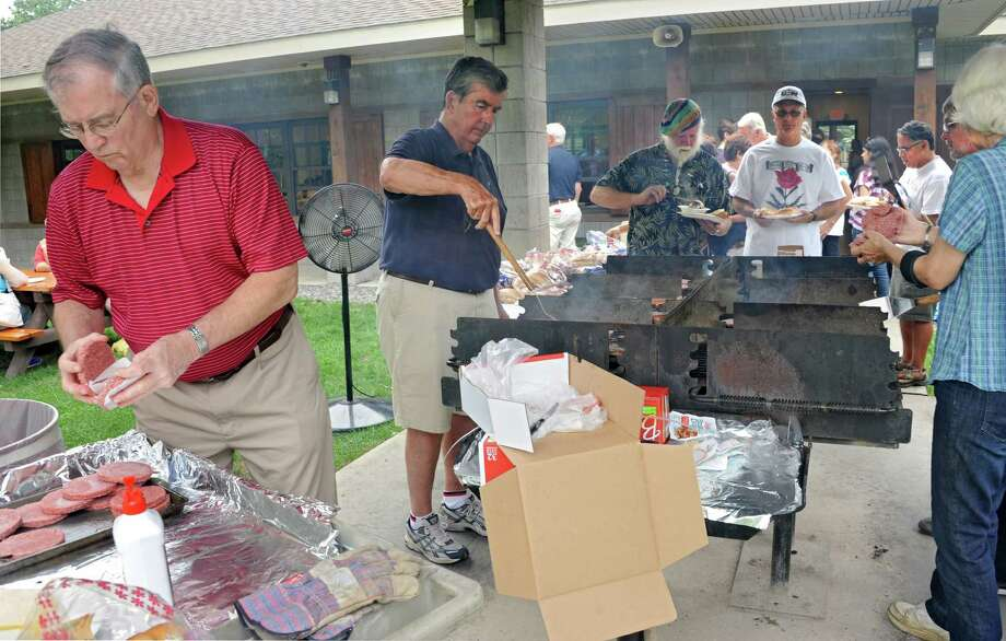 Former Albany County Executive Mike Breslin, left, and his brother Senator Neil Breslin cook hamburgers and hotdogs during the Solidarity Labor Day picnic held at Cook Park on Monday, Sept. 2, 2013 in Colonie, N.Y.  (Lori Van Buren / Times Union) Photo: Lori Van Buren / 00023695A