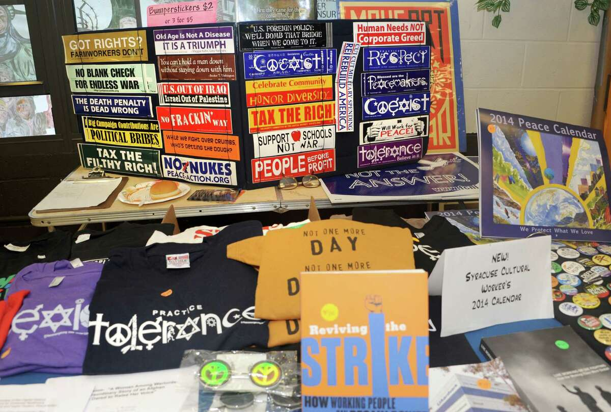 Bumper stickers and other merchandise are for sale at the Solidarity Labor Day picnic held at Cook Park on Monday, Sept. 2, 2013 in Colonie, N.Y. (Lori Van Buren / Times Union)