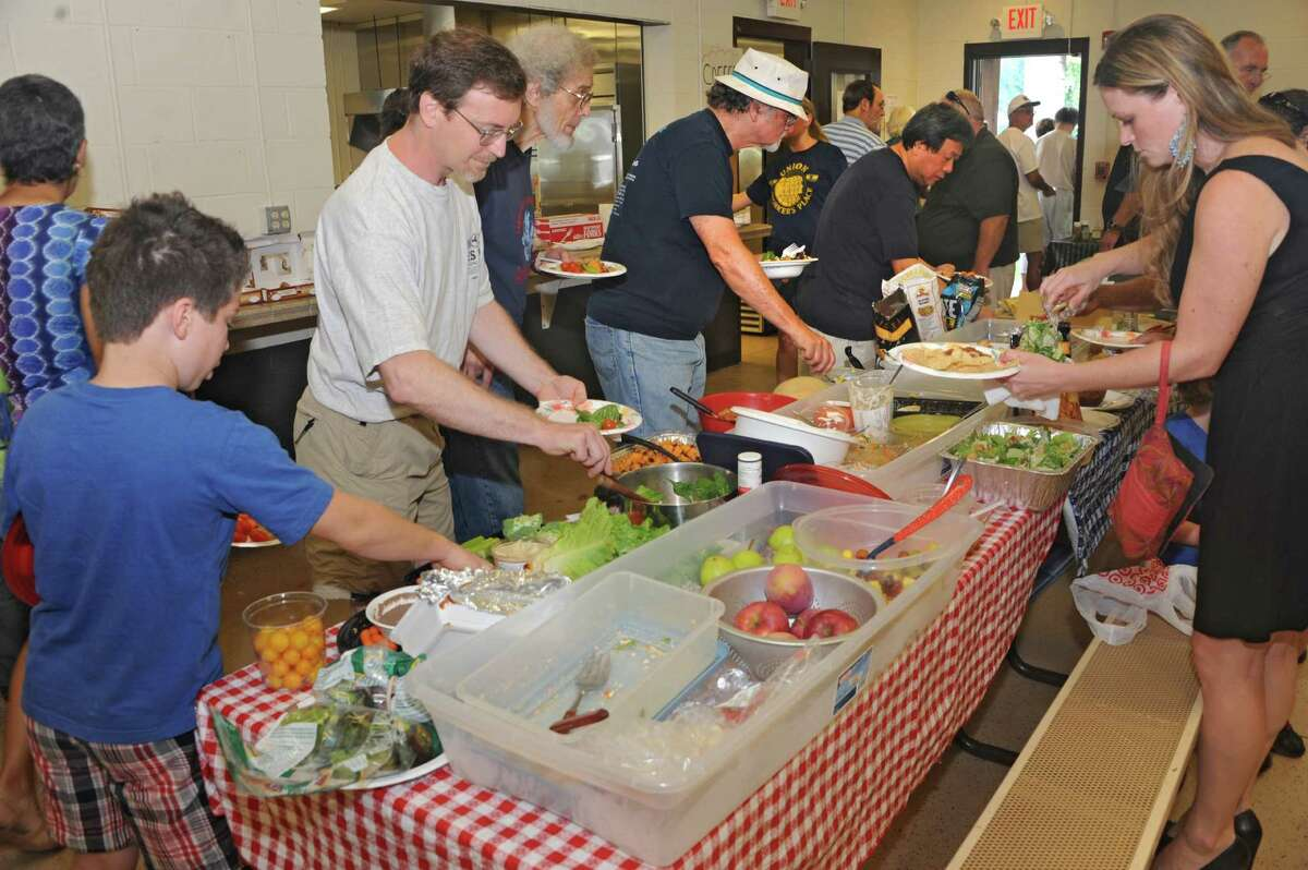 People help themselves to salads and deserts during the Solidarity Labor Day picnic held at Cook Park on Monday, Sept. 2, 2013 in Colonie, N.Y. (Lori Van Buren / Times Union)