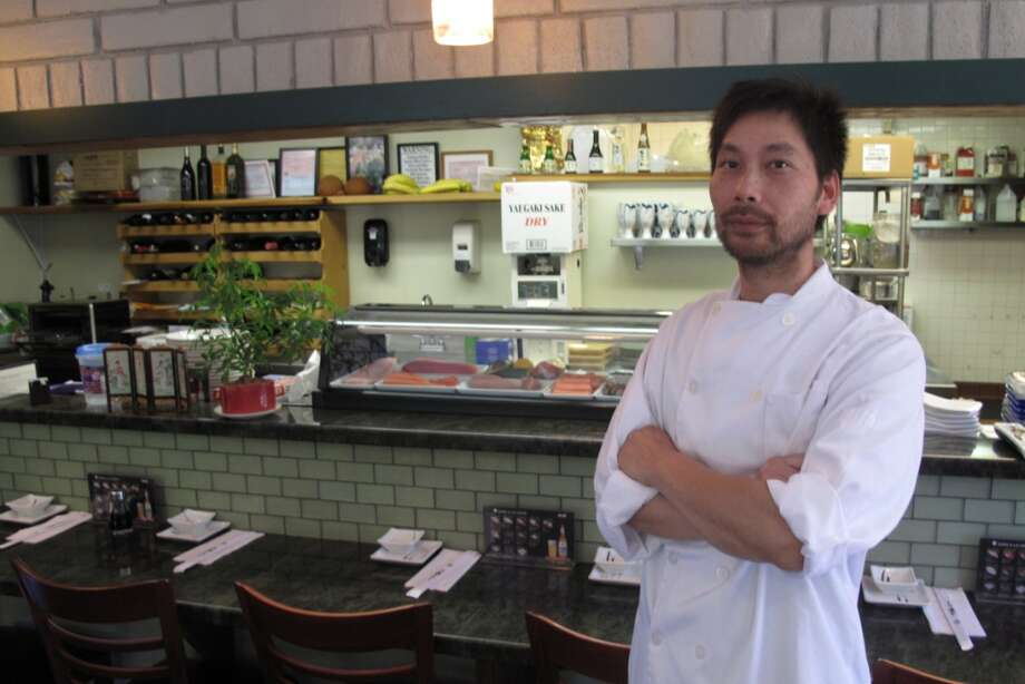Wayne Lei at Wayne's Grill & Sushi. He added hardwood floors, green tile and bamboo -- but kept the beige brick from the old Taco Bell. He built a bar and displays fish where the counter used to be. Photo: Peter Hartlaub, The Chronicle