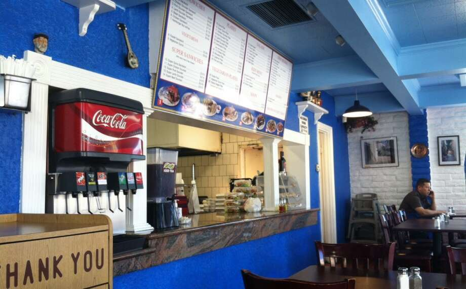 At Yaissoo Greek Specialties in Cupertino, the counter hasn't changed much from its Taco Bell days. But molding has been added, the walls are blue and white and a more attractive ceiling was built. Photo: Peter Hartlaub, The Chronicle