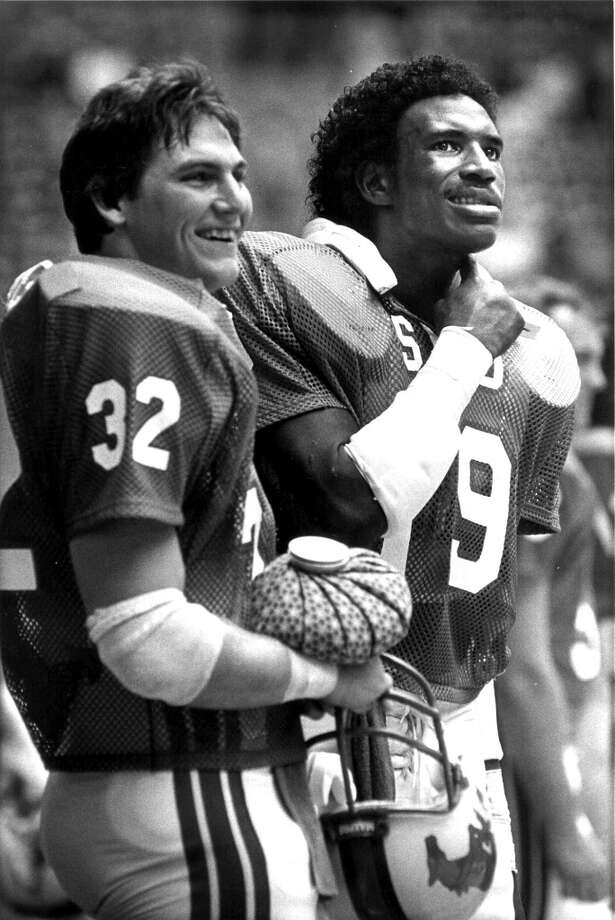 In this 1982 file photo Southern Methodist running backs Craig James, left and Eric Dickerson stand on the sideline during a Southwest Conference Game in Irving, Texas. Photo: AP*STEW*
