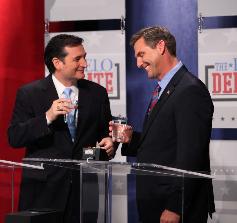 Republican candidates for U.S. Senate, Craig James, right, and Ted Cruz laugh about a text Cruz sent James earlier this week prior to the Belo Debate Friday night, April 13, 2012 at the WFAA studios in Dallas, Texas. The four (including Lt. Governor David Dewhurst and Tom Leppert) are vying  for the seat of retiring Sen. Kay Bailey Hutchison. (Brad Loper/The Dallas Morning News) Photo: Brad Loper, Staff Photographer