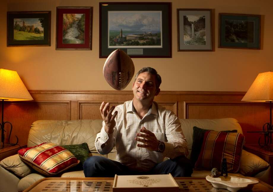 Craig James tosses a football into the air at his father-in-law's home Friday, Feb. 3, 2012, in The Woodlands. James is a former SMU football star, New England Patriot and ESPN commentator. (Cody Duty / Houston Chronicle) Photo: Cody Duty, Houston Chronicle