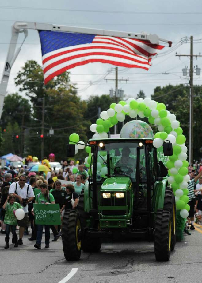 "The Sandy Hook School float finishes the route of the 52nd Annual Newtown Labor Day Parade in Newtown, Conn. on Monday, Sept. 2, 2013.  About 100 floats and groups participated in the parade, themed ""We are Newtown - marching strong."" Photo: Tyler Sizemore / The News-Times"