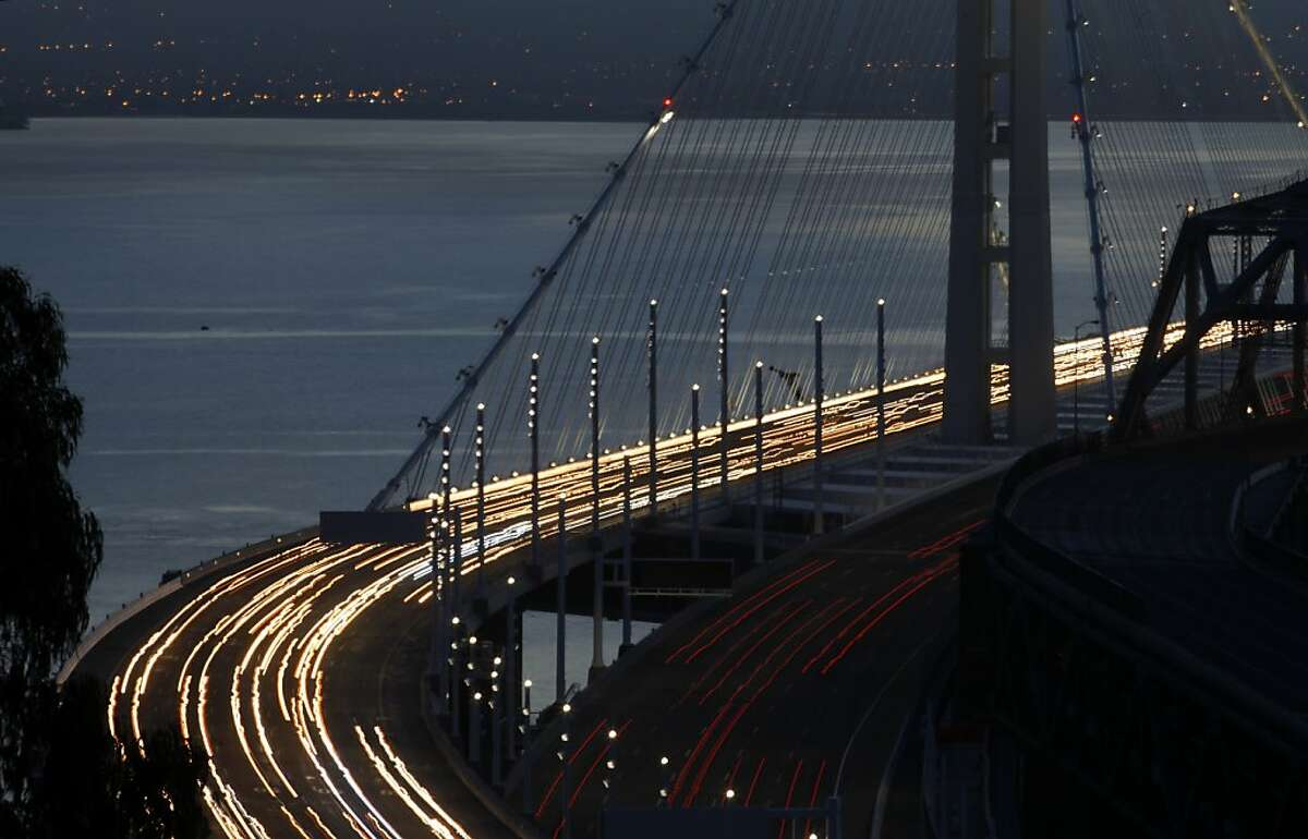 Commuters drive over the eastern span of the new Bay Bridge from the East Bay as the sunrises, Tuesday September 3, 2013, from the Yerba Buena Island, San Francisco, Calif. The bridge which ran over 8 billion dollars over budge opened early Monday night.