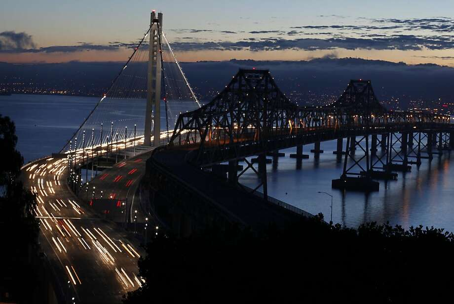 Gunmen fired shots into a party bus near the eastern end of the Bay Bridge early Saturday, March 12, 2016 and injured four people, the California Highway Patrol said. File photo of the Bay Bridge. Photo: Lacy Atkins, The Chronicle