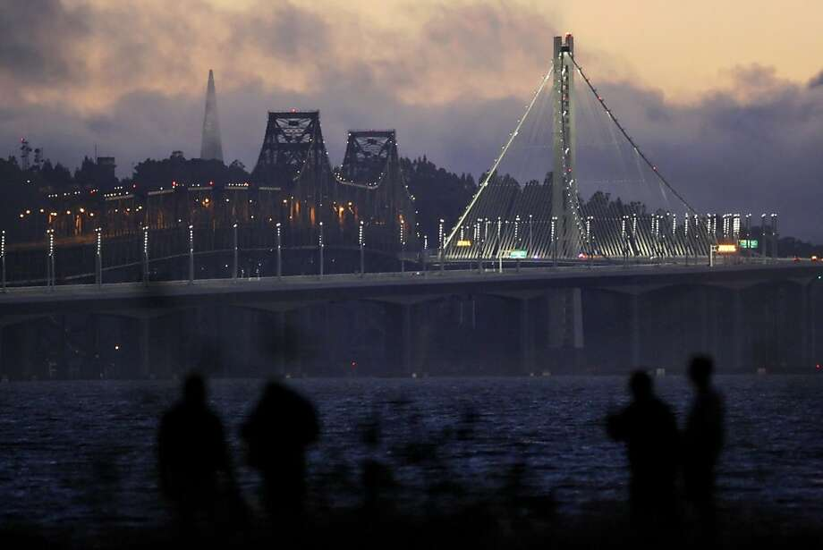 Drivers wait along Powell Street in Emeryville, Calif., for the new eastern span of the Bay Bridge to open on Monday evening. They were rewarded  shortly after 10pm Monday September 2, 2013 as the bridge was opened hours ahead of schedule. Photo: Carlos Avila Gonzalez, The Chronicle