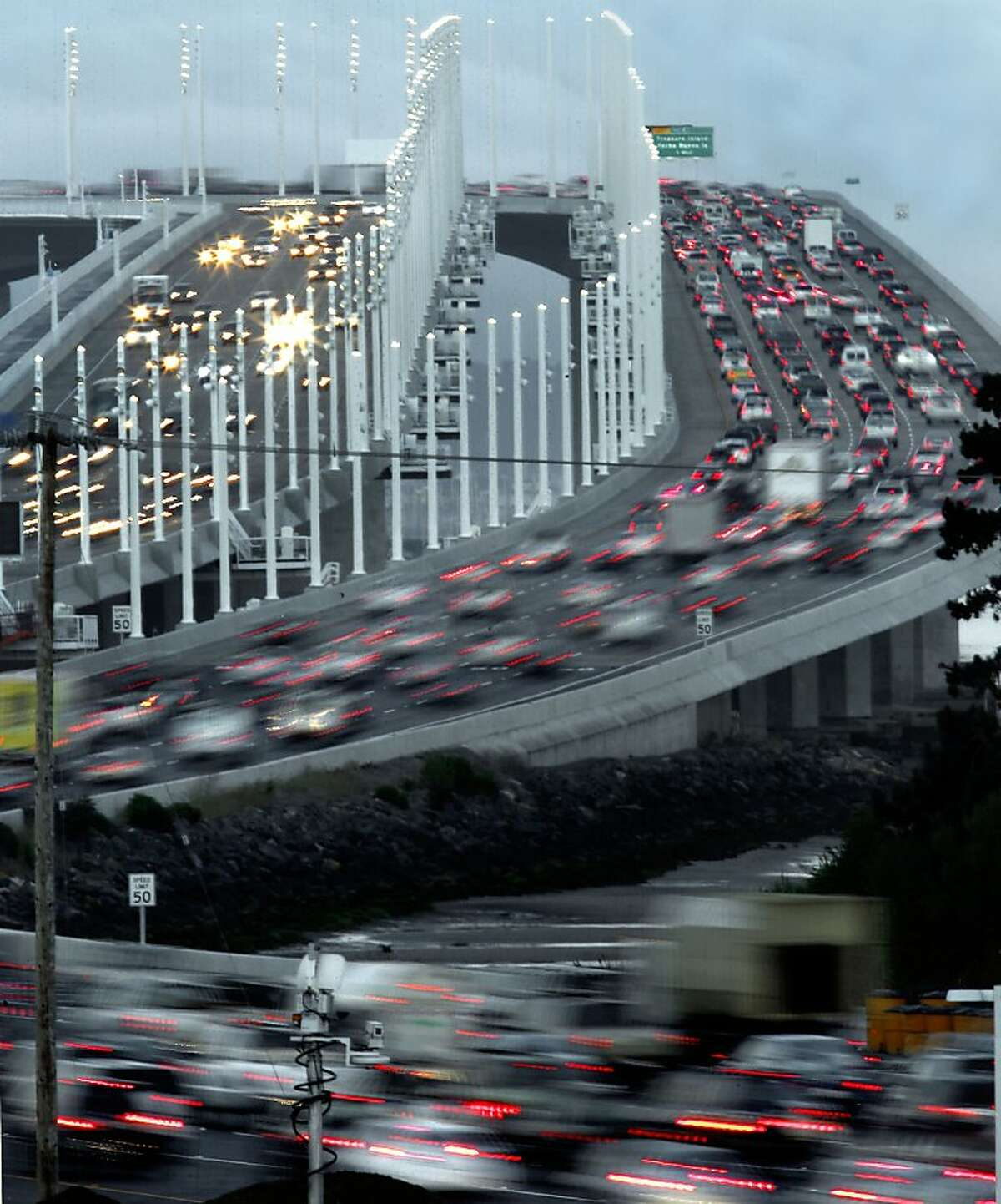 The morning commute in full swing as motorists make their way east and west bound across the roadway, in Oakland, Calif. on Tuesday Sept. 3, 2013, after the new eastern span of the Bay Bridge opened late last evening to traffic.
