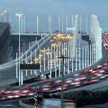 Motorists travel east and west bound during morning commute, in Oakland, Calif. on Tuesday Sept. 3, 2013, after the new eastern span of the Bay Bridge opened late last evening to traffic.