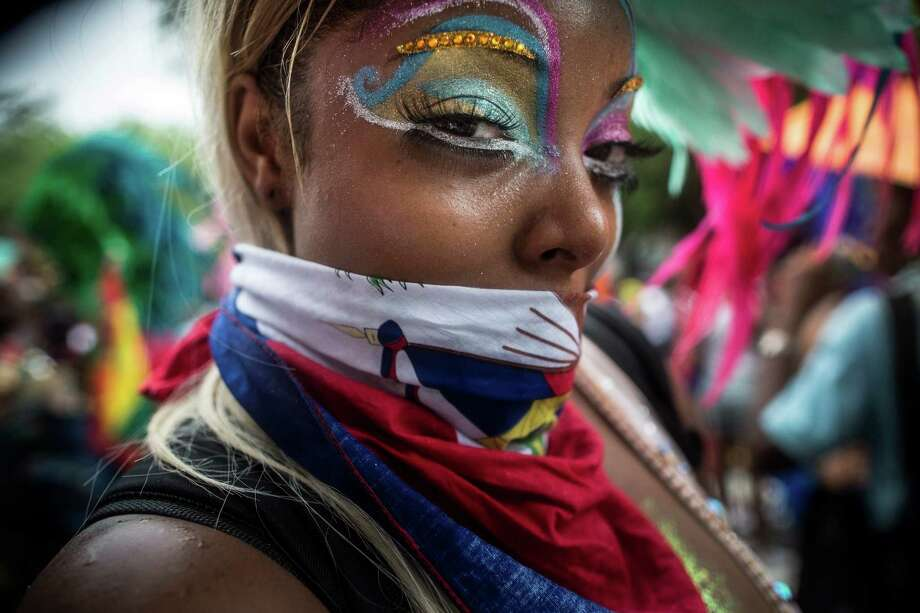 NEW YORK, NY - SEPTEMBER 02:  A woman poses for a portrait during the annual West Indian Day Parade on September 2, 2013 in the Crown Heights neighborhood of the Brooklyn borough of New York City. The parade, which is estimated to draw 3 million particants and viewers, is a celebration of Carribean culture including dance, food, drink and costumes. Each year the parade is also marred by violence; at least one shooting and one stabbing have been reported this year.  (Photo by Andrew Burton/Getty Images) ORG XMIT: 179200597 Photo: Andrew Burton, Getty / 2013 Getty Images