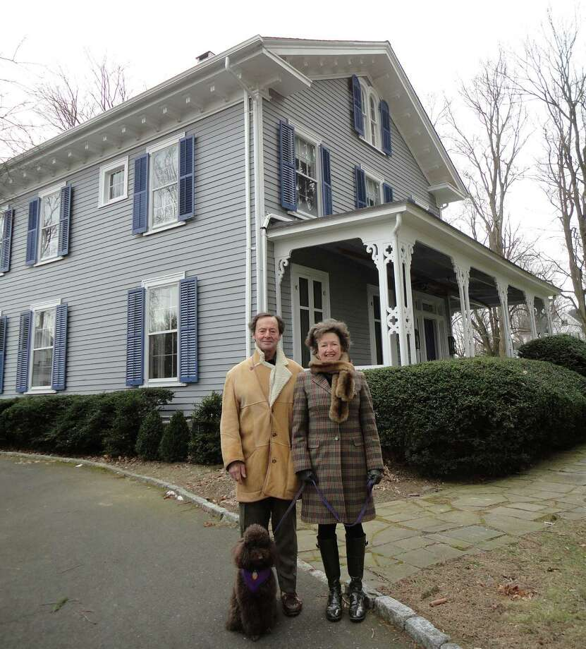 Jarvis and Coke Anne Wilcox and their dog Cocoa in front of the historic house at 25 Turkey Hill Road South earlier this year. They had proposed converting the house into a bed and breakfast, but the property is now on the market. Photo: File Photo / Westport News