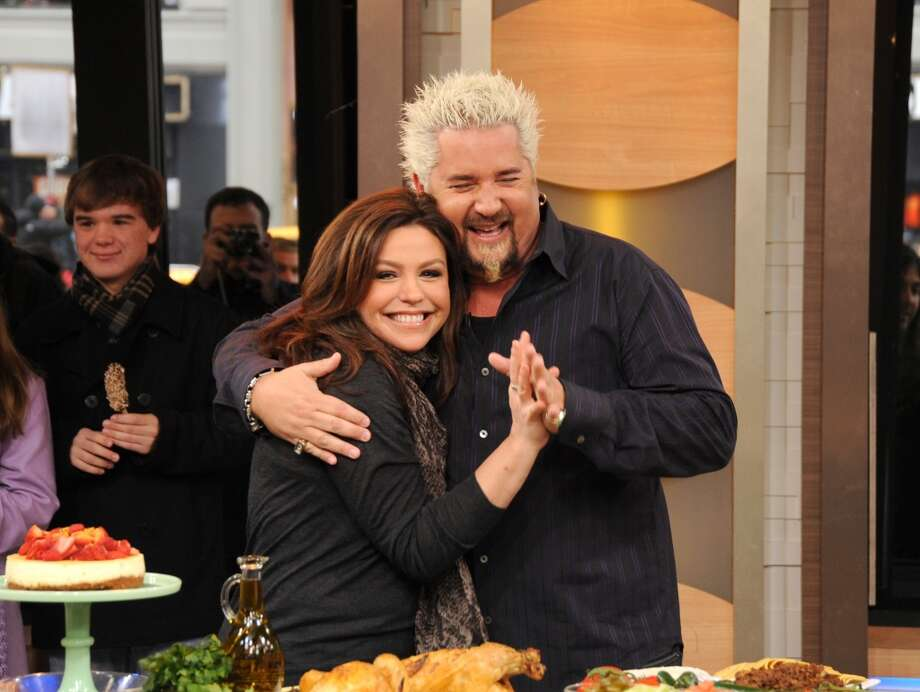 "GOOD MORNING AMERICA - Rachael Ray and Guy Fieri face off in a celebrity cook off on ""Good Morning America,"" 1/9/13, airing on the ABC Television Network. (Photo by Donna Svennevik/ABC via Getty Images) RACHAEL RAY, GUY FIERI Photo: ABC Via Getty Images"