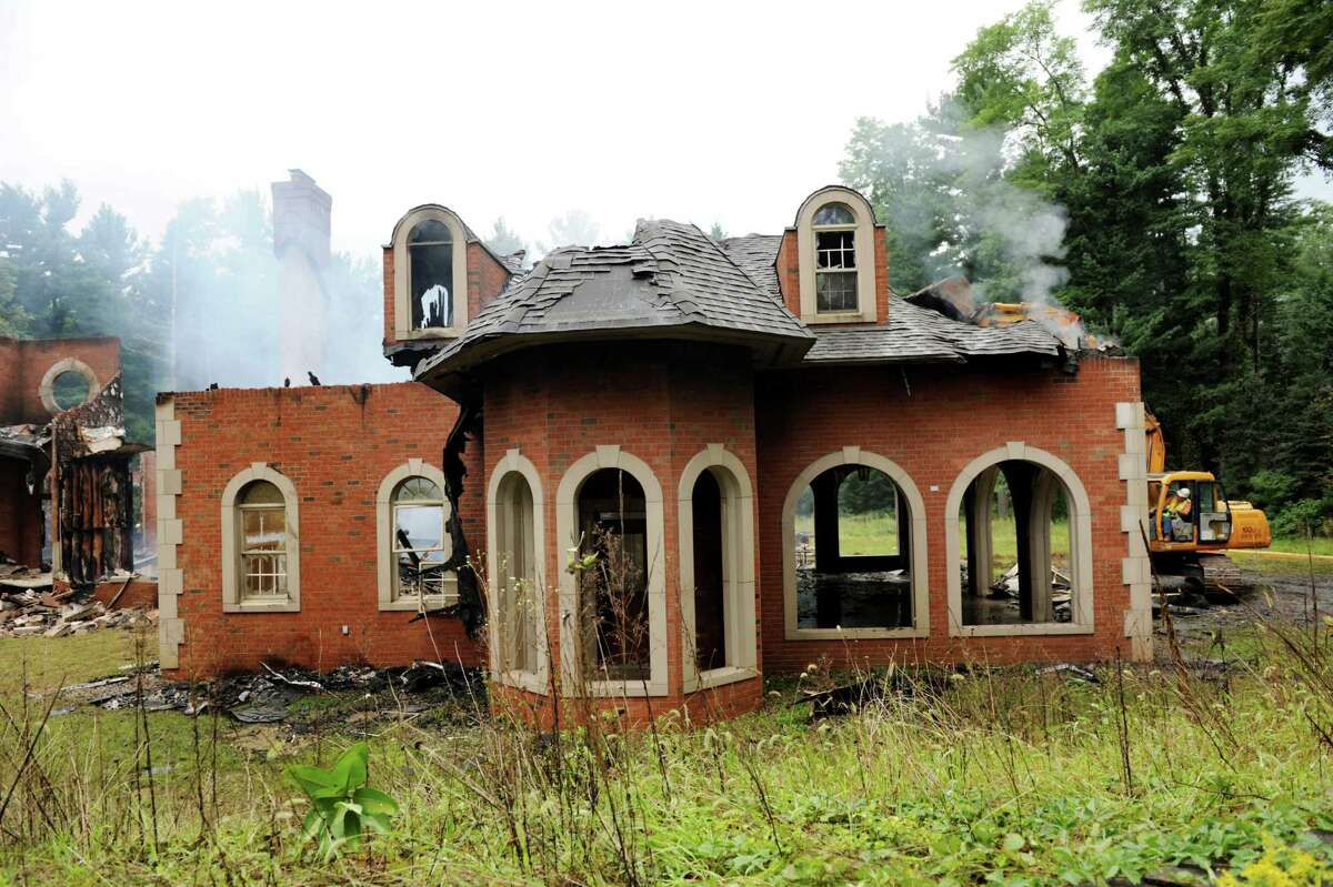 Early morning fire destroys a mansion at 3494 Lydius St. on Tuesday, Sept. 3, 2013, in Guilderland, N.Y. (Cindy Schultz / Times Union)