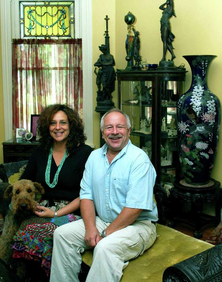 Bob Krethcko Antique in New Milford is a ìpassionî for owners Bob and Loretta Kretchko, according to a family friend. Above, the Kretchkos are shown with their dog, Tallulah.  For 9/6/13 Chamber Business Quarterly Photo: Deborah Rose