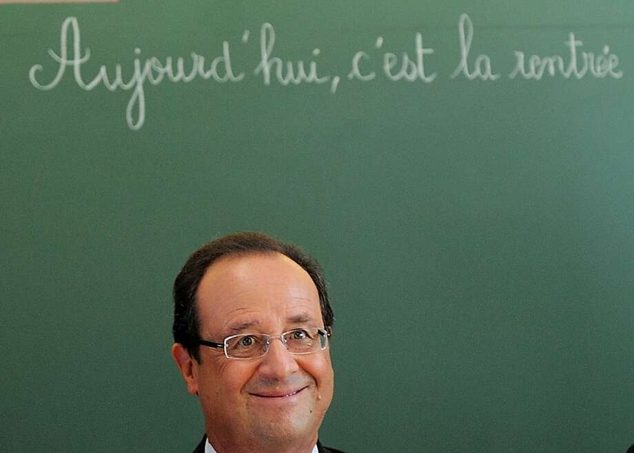 "French President Francois Hollande sits for a discussion as he visits the school Michelet for the start of the school year, in Denain, northern France, Tuesday, Sept. 3, 2013. The board reads : Today, it is the start of school year"" (AP Photo/ Denis Charlet, Pool) Photo: Denis Charlet, Associated Press"