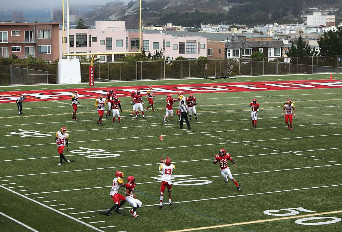 Berkeley senior Jakari Simpson, #13, makes an interception at Washington High School on August 31, 2013 in in San Francisco, Calif. Washington played Berkeley to a 40-8 loss in the first game of the season.