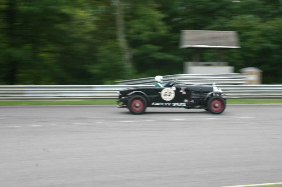Vintage cars race at the Historic Festival at Lime Rock Park in 