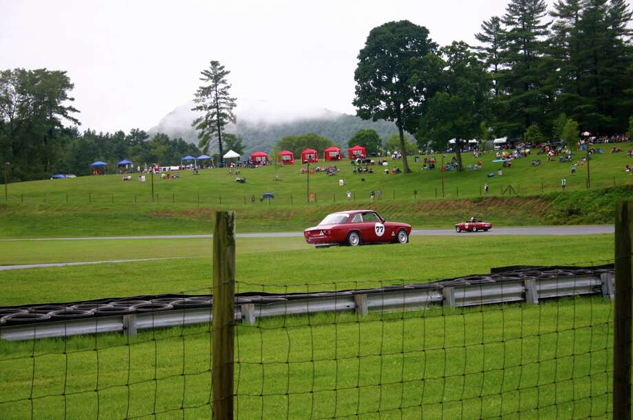 Vintage cars race at the Historic Festival at Lime Rock Park in  Lakeville, Conn. over Labor Day Weekend. Hundreds of vintage European,  American and Japanese cars — worth millions of dollars collectively —  hit the famed road course at Lime Rock once a year. Photo: Ryan Kundrat