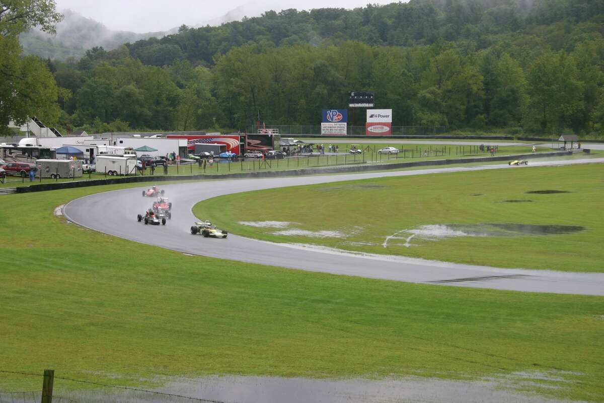 Vintage cars race at the Historic Festival at Lime Rock Park in Lakeville, Conn. over Labor Day Weekend. Hundreds of vintage European, American and Japanese cars - worht millions of dollars collectively - hits the famed road course at Lime Rock once a year.