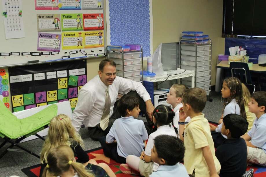Tim Patton, the new dean at The Woodlands Preparatory School, interacts with first-graders. Photo: Photo Courtesy Of The Woodlands Preparatory School