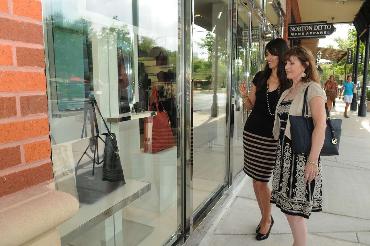 Vanessa Johnson, from left, of Conroe, and Michelle Smith Gonzales, of The Woodlands, window shop at Tumi, one of the new stores to open recently at Market Street in The Woodlands. Freelance photo by Jerry Baker