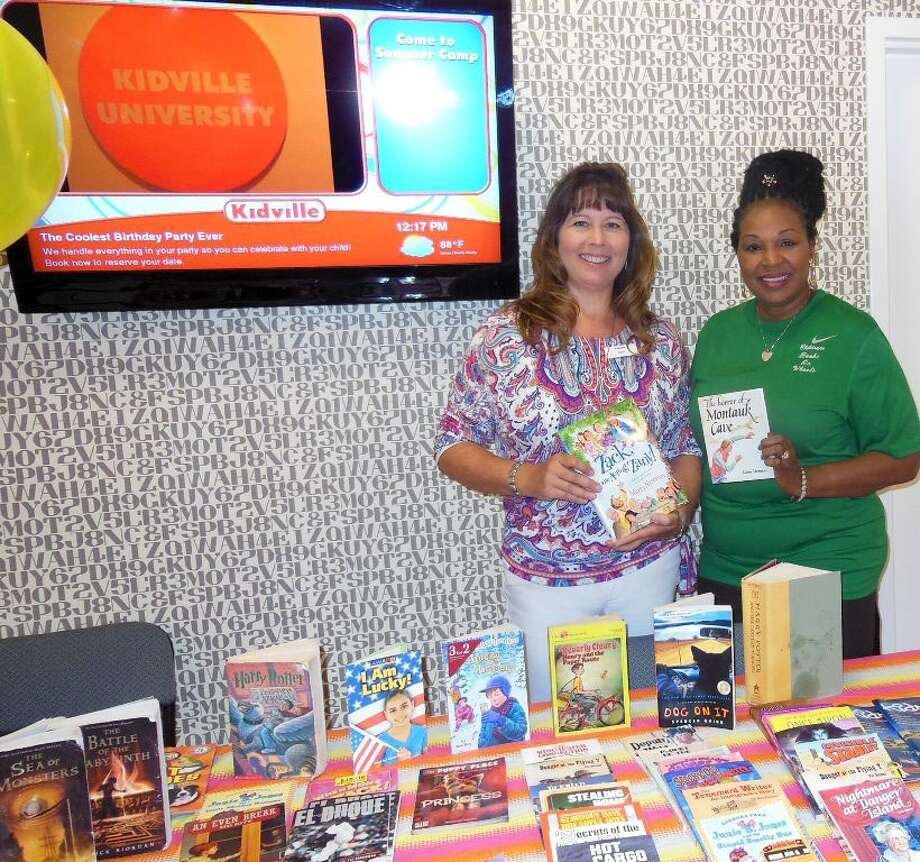 Kidville The Woodlands owner Karen Roberts and Books on Wheels executive director Rita Wiltz participate in a benefit safety event for children. Photo: Contributed Photo