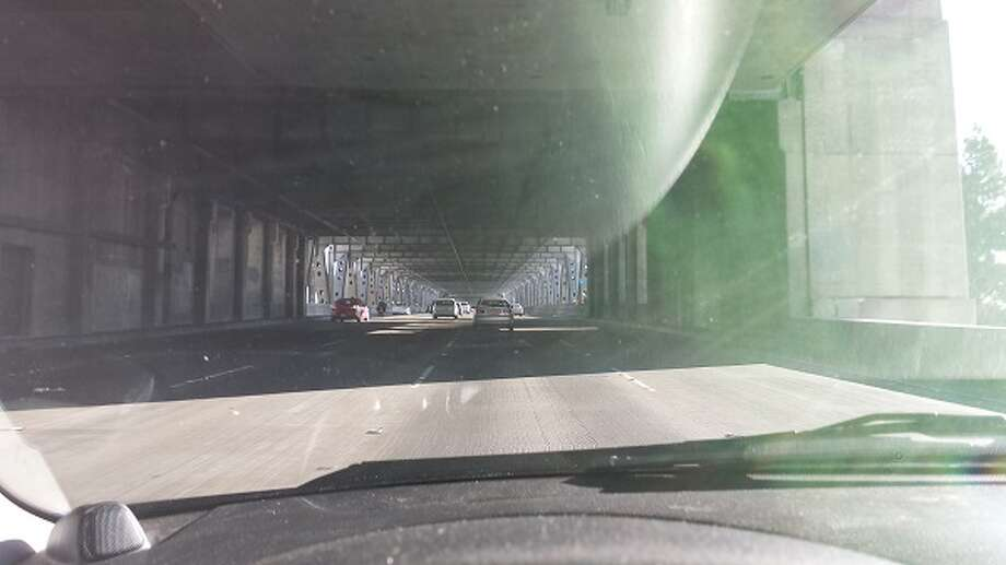 Before: Driving through the eastbound part of the old San Francisco-Oakland Bay Bridge, approaching the new span, which connects Yerba Buena Island to Alameda County. See how cloistered the old bridge looks. You're in a cage, on the lower deck of the bridge. (All photos taken by Michael Taylor, less than 12 hours after the new bridge opened to the public.)