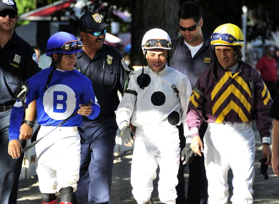 "On the way to the Saratoga paddock, from left to right: Luis Saez, Joel Rosario & Edgar Prado. Both Joel and Edgar have won the Kentucky Derby, but don't count out the twenty year old sensation ""Luis Saez"". Saez won the first race on opening day at the Spa. Fleetphoto (George Zilberman)"