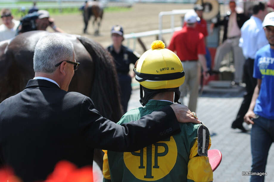 "Irad Ortiz, Jr. gets a ""pat on the back"" for a job well done. (Ed Sindoni) Photo: Picasa"