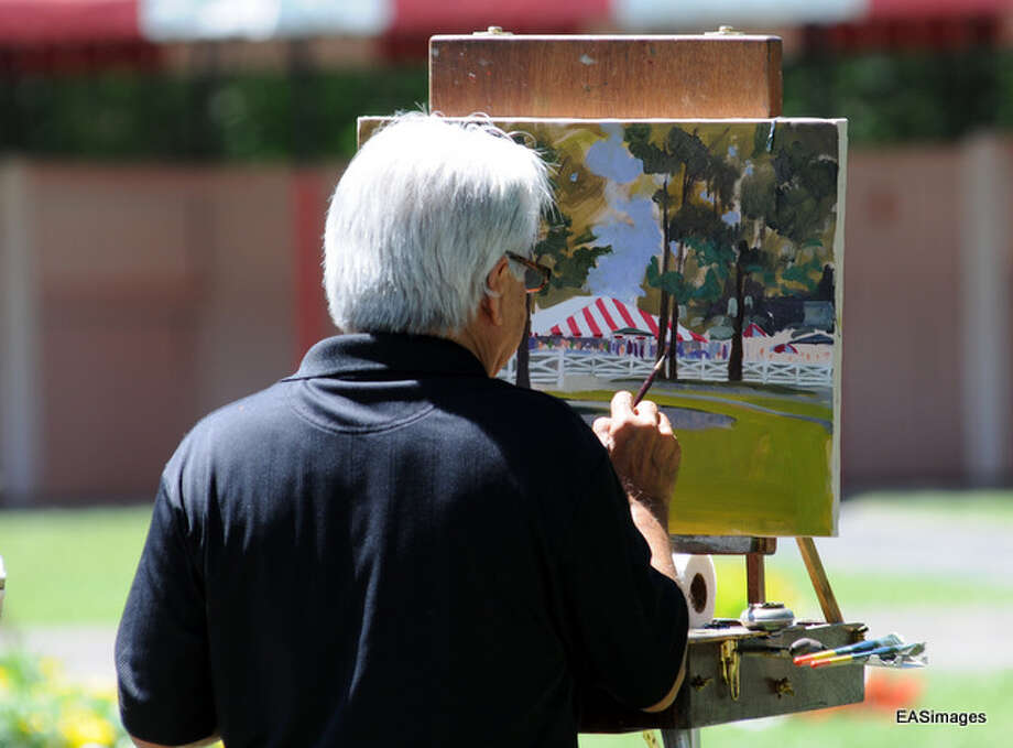 In the paddock area, artists use their talent to capture the action. (Ed Sindoni) Photo: Picasa