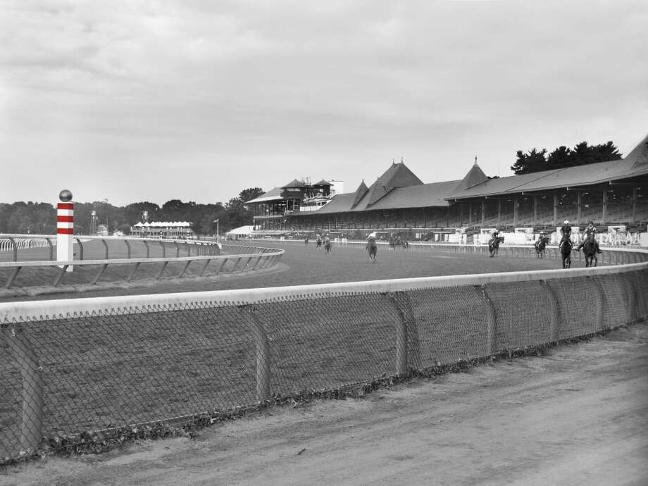 The Saratoga turn into the stretch on opening day. Celebrating 150 years of tradition, history and horses, this photo is a reminder of all the past champions that have made this turn into the stretch. Fleetphoto (George Zilberman)