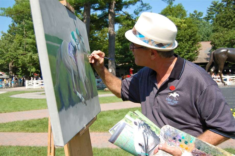 Artist Robert Clark painting in the paddock. (Michael Mancino)