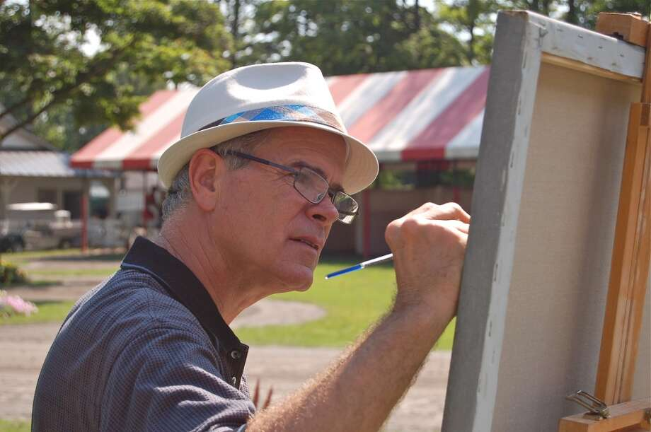 Artist Robert Clark painting in the paddock. (Michael Mancino)