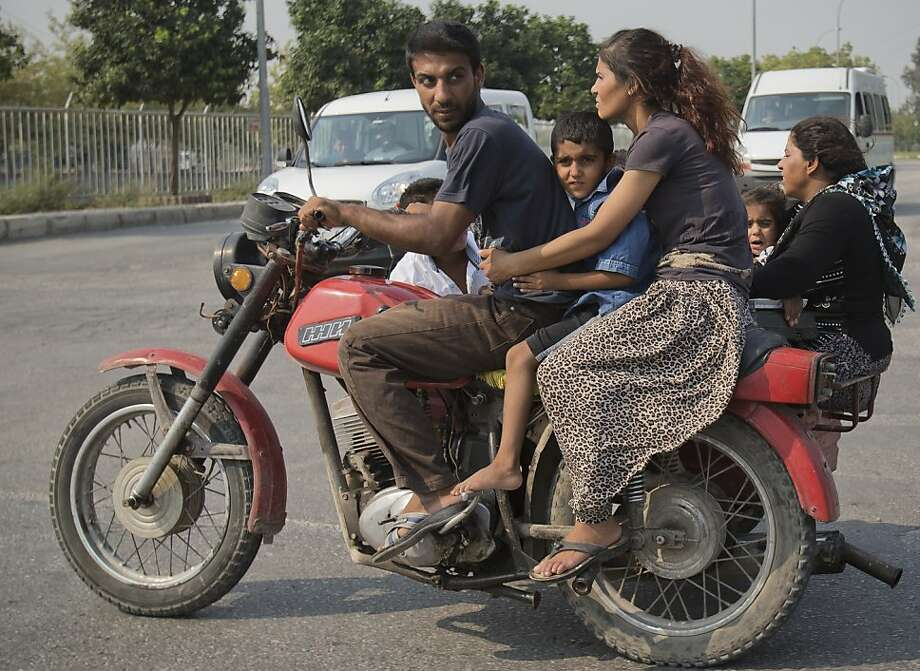 Turkish SUV: Two-wheeled transportation carries a family of six in Adana, Turkey. Photo: Vadim Ghirda, Associated Press