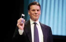 Former president and CEO of Nokia Olli-Pekka Kallasvuo shows a new flip phone during a press conference at the World Mobile Congress, in Barcelona in February 2008.