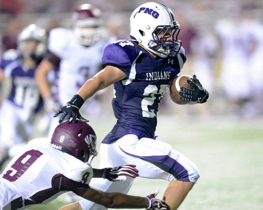 Port Neches-Groves running back Brant Halfin, right, eludes Silsbee defender Travonte Davis, left, on his way to a 27-yard touchdown in the first half of Friday night's game at The Reservation in Port Neches. The Indians won 45-21. Photo provided by Brian Vincent
