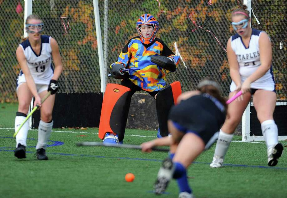 Staples' Jodie Baris defends the goal during their field hockey game against Darien at Staples High School in Westport. Photo: Autumn Driscoll / Connecticut Post