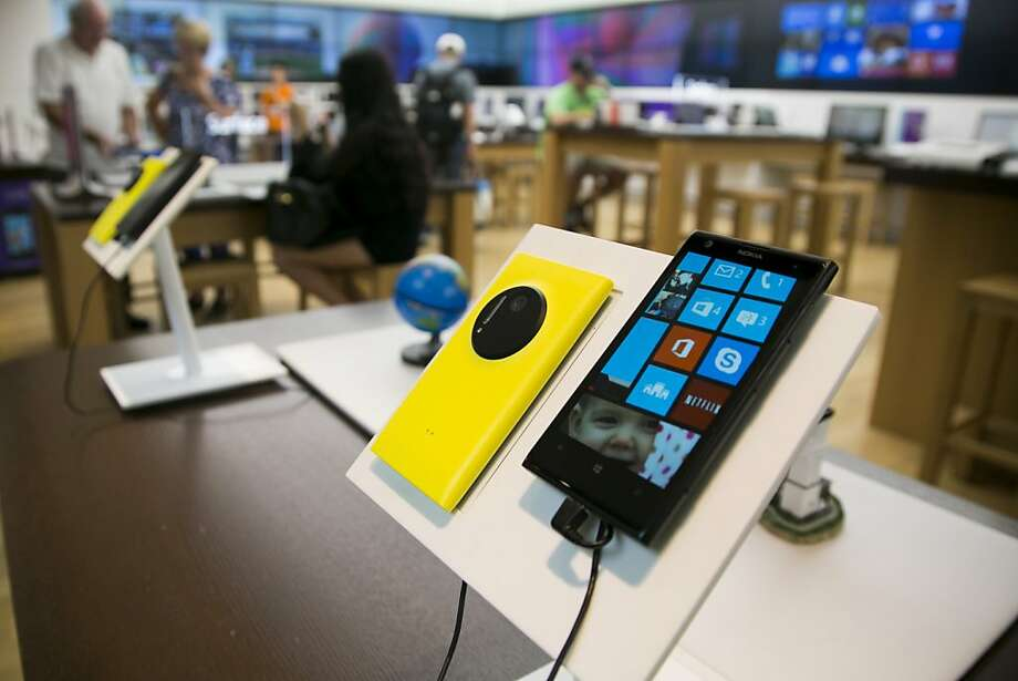 Under the deal, Microsoft gets the Lumia brand for its devices, like this Nokia Oyj Lumia 1020 tablet. Photo: Kelvin Ma, Bloomberg