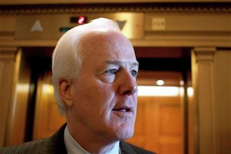 Sen. John Cornyn, R-Texas is seen on Capitol Hill in Washington, Wednesday, Feb. 24, 2010, following the Senate vote on the jobs bill. (AP Photo/Harry Hamburg) Photo: Harry Hamburg, AP / FR170004 AP