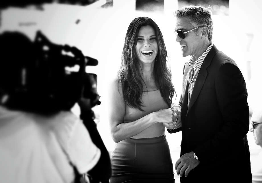 Sandra Bullock and George Clooney who attend the 'Gravity' photocall at the 70th Venice International Film Festival on August 28, 2013 in Venice, Italy. Photo: Andreas Rentz, Getty Images / 2013 Getty Images