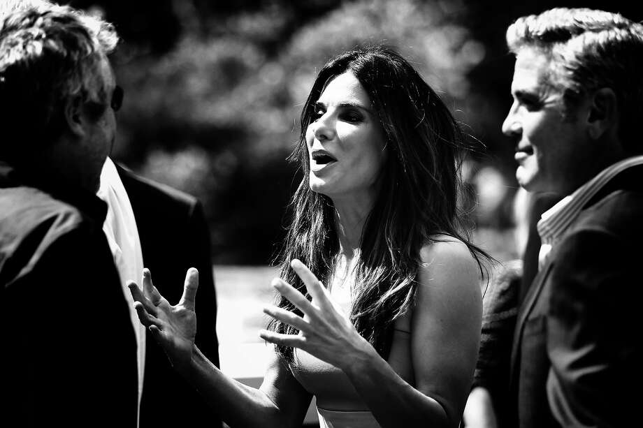 Director Alfonso Cuaron (L) ; actors Sandra Bullock and George Clooney who arrive at the 'Gravity' photocall at the 70th Venice International Film Festival on August 28, 2013 in Venice, Italy. Photo: Andreas Rentz, Getty Images / 2013 Getty Images