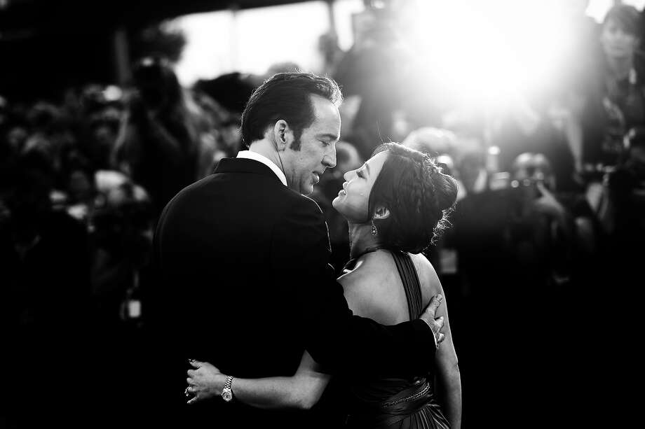 Actor Nicolas Cage who kisses his wife Alice Kim Cage at the 'Joe' Premiere during the 70th Venice International Film Festival on August 30, 2013 in Venice, Italy. Photo: Vittorio Zunino Celotto, Getty Images / 2013 Getty Images