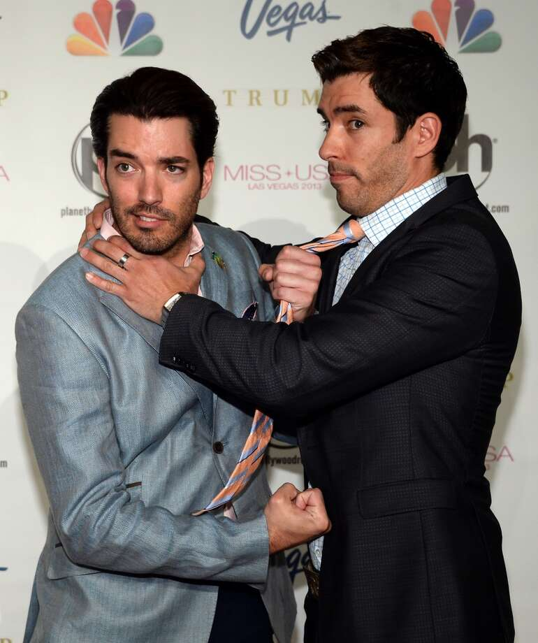 Identical twin brothers Jonathan, left, (L) and Drew Scott are the stars of `Property Brothers' on HGTV. Jonathan is a contractor and Drew is a real estate guy. On the show they find run-down homes and fix them up for couples on a budget. Photo: Ethan Miller, Getty Images