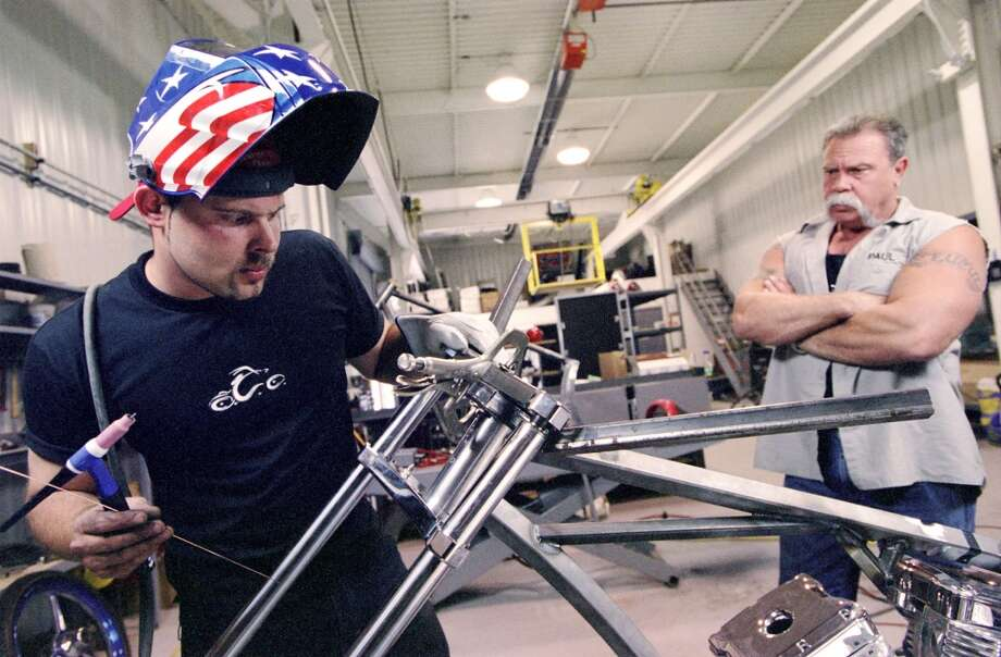 Paul Teutul Jr., left, and his father, Paul Sr., took their popular Orange County Choppers to TV on Discovery Channel's `American Chopper.' Photo: DAVID SUROWIECKI, AP