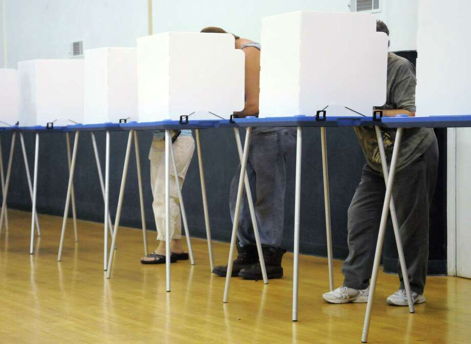 Voters fill out their primary ballots at the Bethlehem Town Hall polling station in Delmar N.Y., Thursday lunchtime Sept. 13, 2012. (Will Waldron / Times Union) Photo: Will Waldron / 00019148A