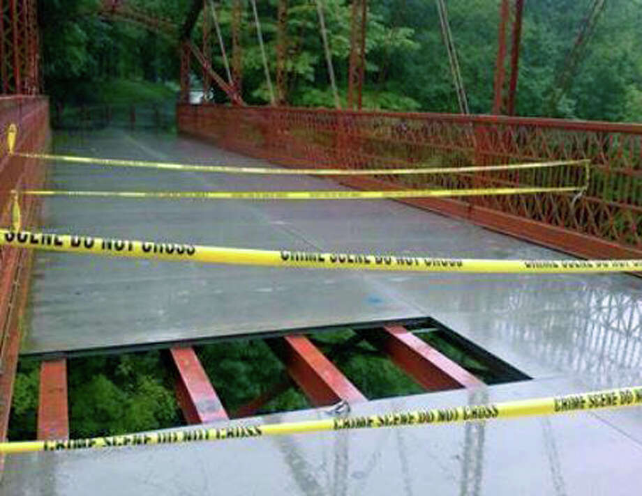 Bridge closed  The historic 19th century bridge at Lovers Leap State Park in New Milford is closed to foot traffic after vandals tore up a section of the walkway. Photo: Contributed Photo
