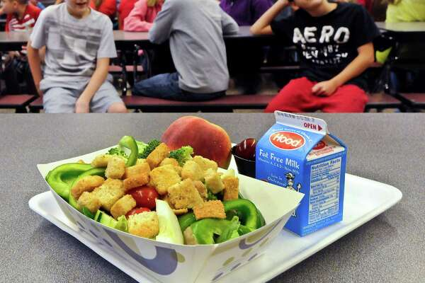 FILE - In this Tuesday, Sept. 11, 2012 file photo, a select healthy chicken salad school lunch, prepared under federal guidelines, sits on display at the cafeteria at Draper Middle School in Rotterdam, N.Y.  After just one year, some schools across the nation are dropping out of what was touted as a healthier federal lunch program, complaining that so many students refused the meals packed with whole grains, fruits and vegetables that their cafeterias were losing money. (AP Photo/Hans Pennink, File) ORG XMIT: NYR202