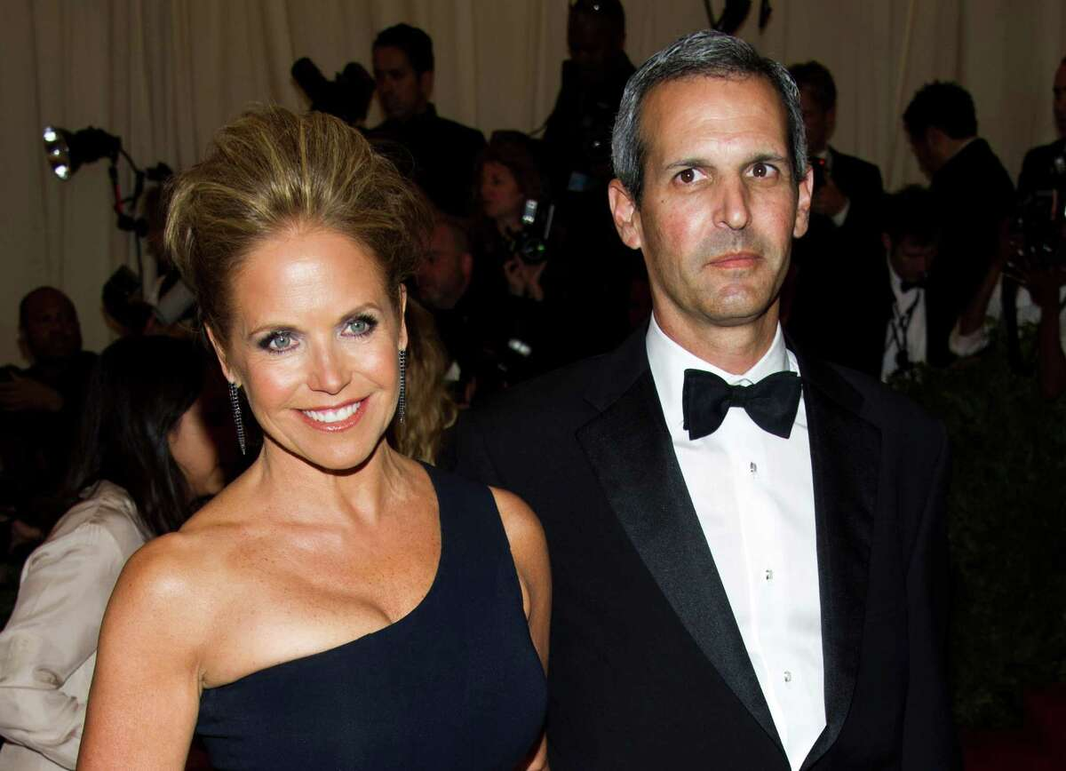 FILE - In this May 6, 2013 file photo, TV personality Katie Couric, left, and John Molner attend The Metropolitan Museum of Art's Costume Institute benefit celebrating