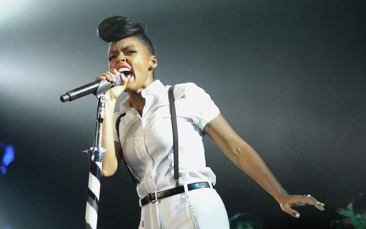 FILE - This July 7, 2013 file photo released by Essence shows Janelle Monae performing at the Essence Festival at the Superdome in New Orleans. Monae will sing at on Rebecca Minkoff?'s show at Lincoln Center, Friday, Sept. 6, during New York Fashion Week as part of ?
